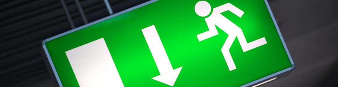 Emergency Lighting Electricians - picture of a green emergency exit sign